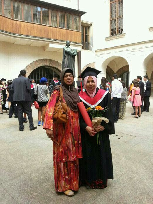 Nor Hasniza Abdul Halim, 25 with her mother Zaiton Abdullah ,53 during the graduation ceremony