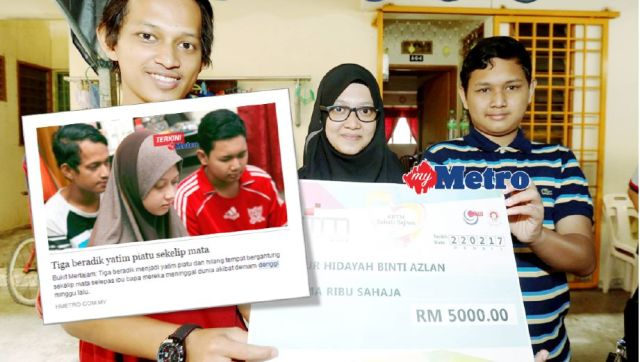 NUR Hidayah Azlan, 23, (tengah) bersama dua adiknya, Muhammad Ridzuan Idzham Azlan, (kiri), 18, dan Muhammad Firdaus Azlan, 14, di Taman Seri Delima, Bukit Mertajam, Pulau Pinang. FOTO Ramdzan Masiam